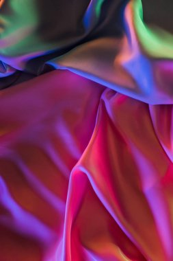 pink and green shiny silk fabric background