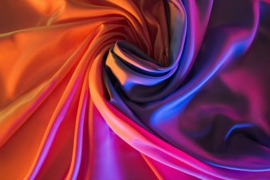 shiny pink and orange silk fabric background