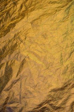 Golden shabby shiny foil background stock vector