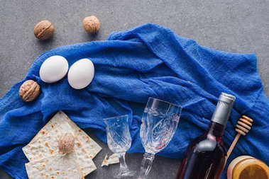 top view of matza, honey and wine on table, Passover Tale concept