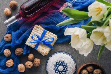 top view of kippah, matza and wine, Pesah celebration concept