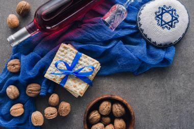 top view of matza, kippah and wine, Pesah celebration concept