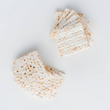 top view of matza on white table, jewish Passover holiday concept