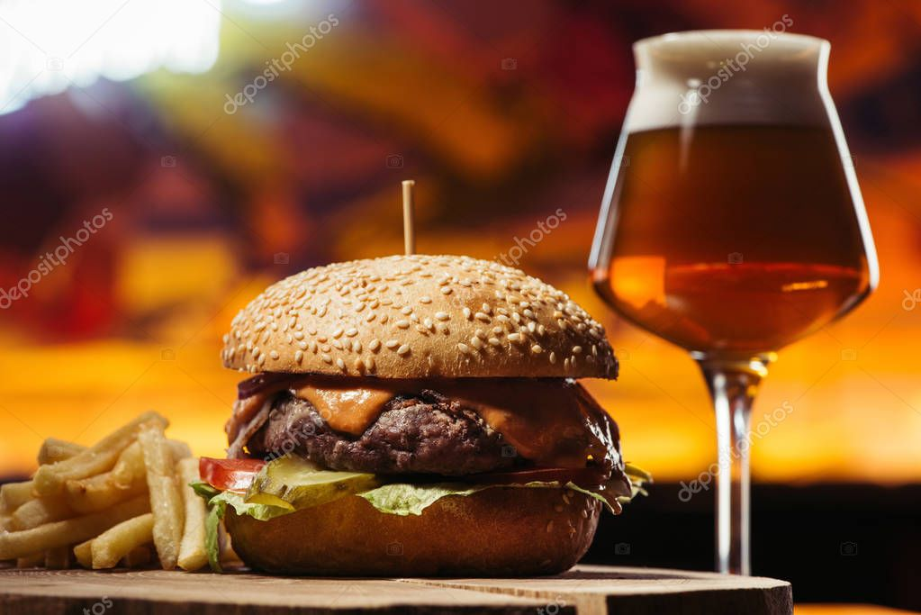 Tasty beef burger with french fries and glass of beer stock vector