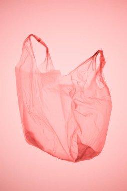 empty plastic bag under pastel pink toned light