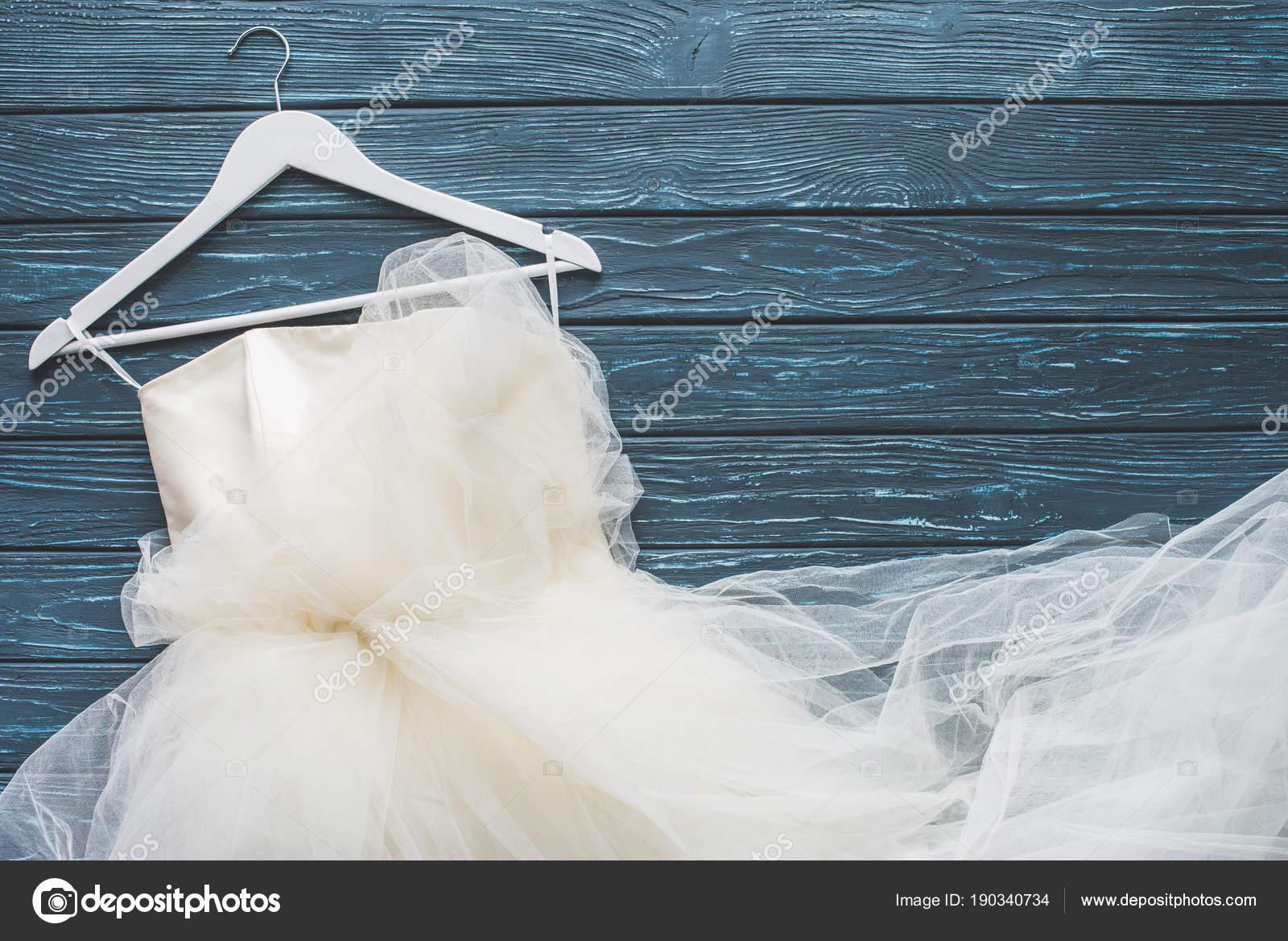 Top View White Wedding Dress Hanger Wooden Dark Blue Tabletop ...