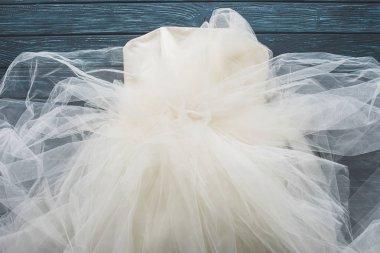 top view of wedding dress on wooden dark blue tabletop