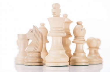 white wooden chess king with knight and bishop on sides on white
