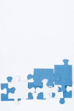 Top view of white and blue puzzles isolated on white, business concept stock vector