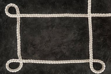 top view of white nautical rope on dark concrete tabletop