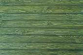 Fényképek Vízszintes fadeszka festett zöld háttér