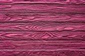 Dřevěná prkna malované růžové pozadí