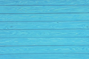 Wooden planks painted in turquoise background