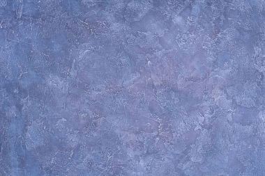 Rough textured purple wall background