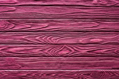 Wooden planks painted in pink background