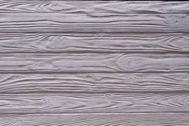 Wooden fence planks background painted in violet