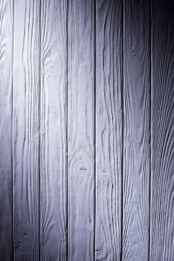 Wooden planks painted in violet background