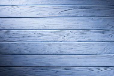 Wooden planks painted in cyan background