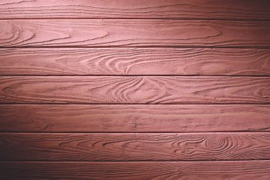 Wooden fence planks background painted in pink