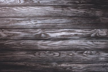 Wooden planks painted in grey background