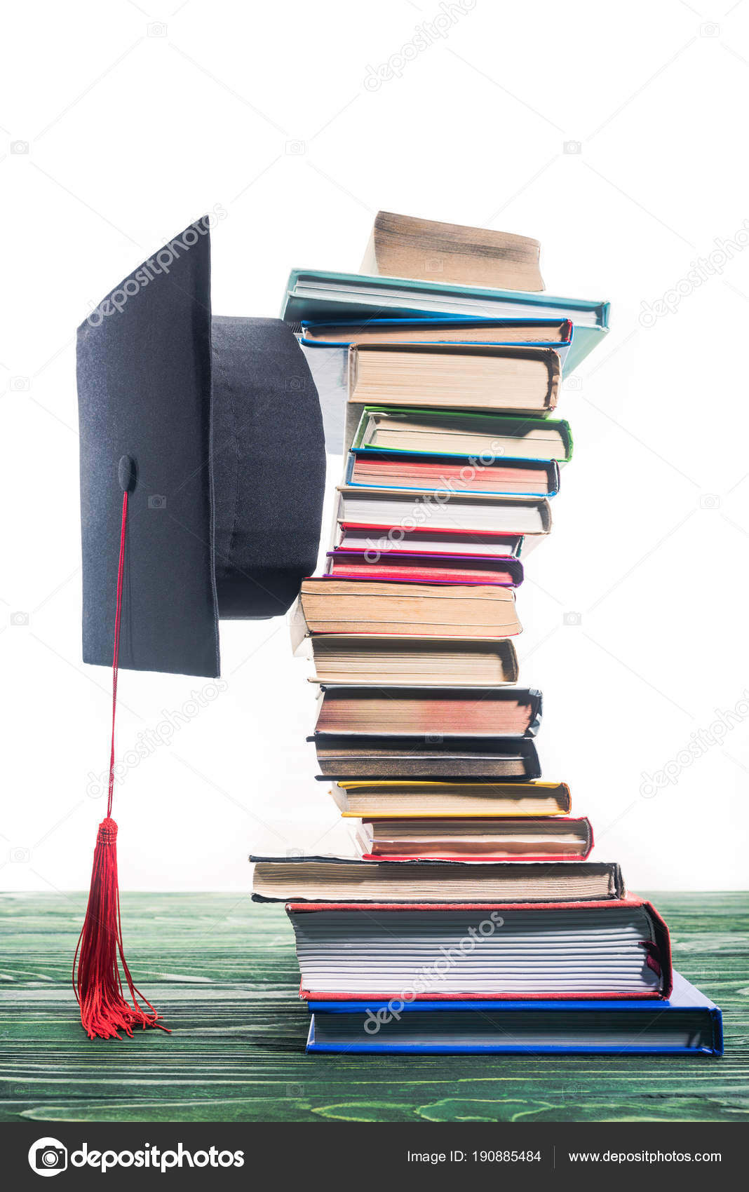 graduation cap fixed stacked books stock photo vadimvasenin