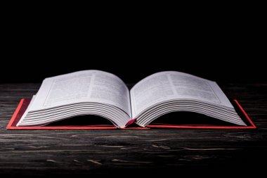 Open book on dark wooden table stock vector