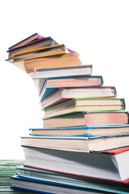 Curved stack of colorful books on table