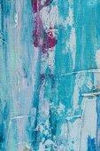 Detailní záběr ze světle modré tahy olejové barvy
