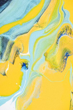 Abstract acrylic texture with yellow and light blue paint