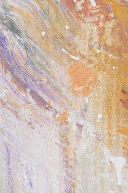 close up of oil painting with white splatters on purple and orange texture
