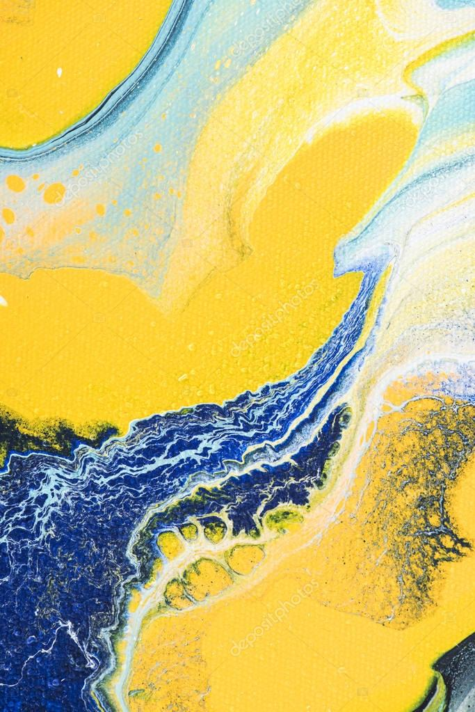 Abstract texture with yellow and blue acrylic paint stock vector