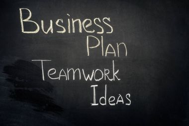 Business plan and teamwork ideas inscription on black chalkboard