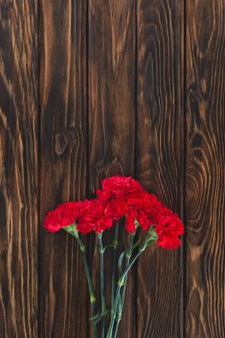 top view of pile of carnations on wooden planks