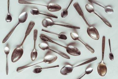 Vintage metal spoons on white background