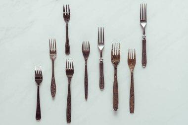 Set of vintage rusted forks on white background