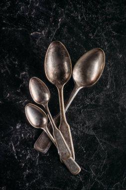 Set of vintage spoons on dark table