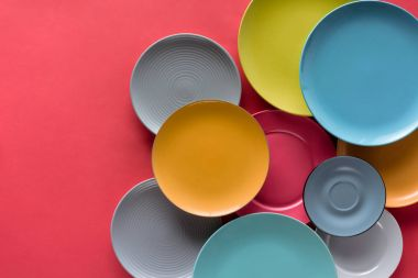 colorful plates composition on red background