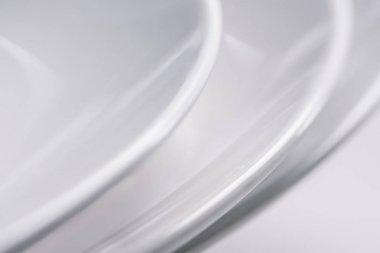 Close-up view of white ceramic plates