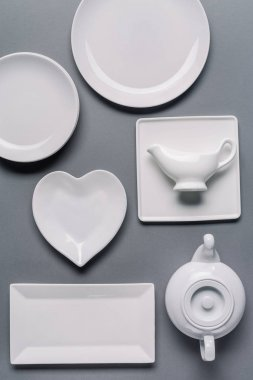 White tableware for dinner time on grey background