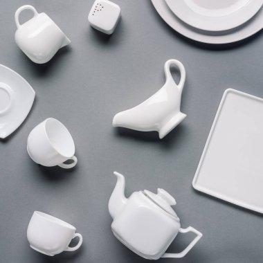 White china tea-set on grey background