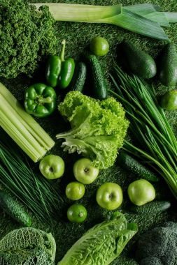 top view of ripe appetizing green vegetables on grass, healthy eating concept