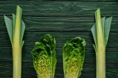 Fotografie top view of green leek and cabbage on tabletop, healthy eating concept