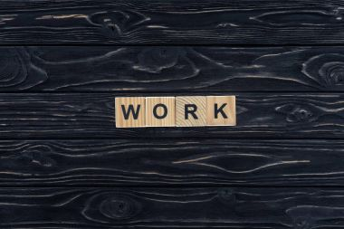 Top view of word work made of wooden blocks on dark wooden tabletop stock vector