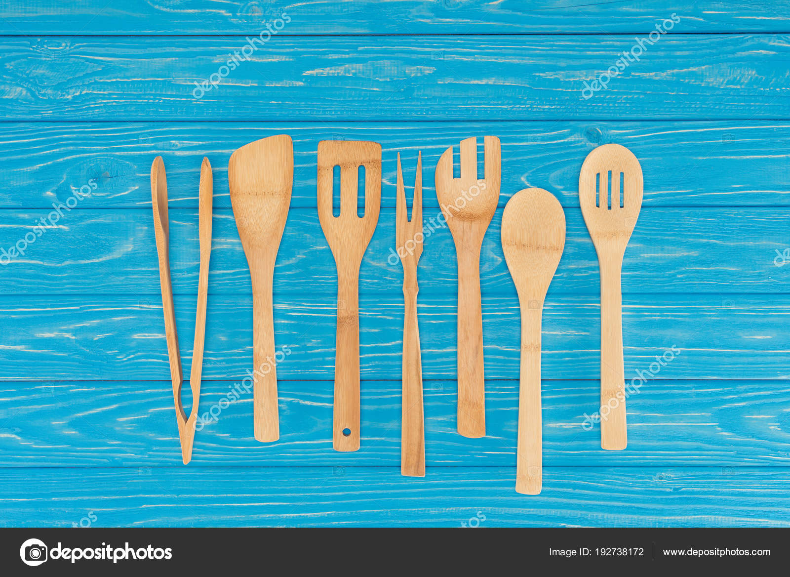 Top View Wooden Kitchen Utensils Placed Row Blue Table — Stock Photo ...