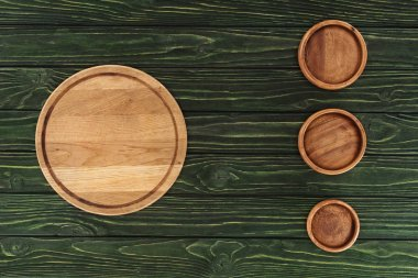 top view of various types of wooden round cutting boards on table