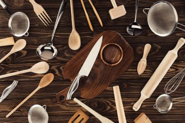 top view of different kitchen utensils on wooden table