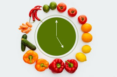 Top view of circle of vegetables and fruits with green clock inside isolated on white stock vector