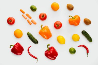 top view of pattern of colored fruits and vegetables isolated on white