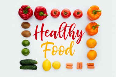 top view of frame with vegetables and fruits and text Healthy Food isolated on white