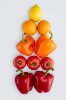 top view of bell peppers, oranges and lemons isolated on white